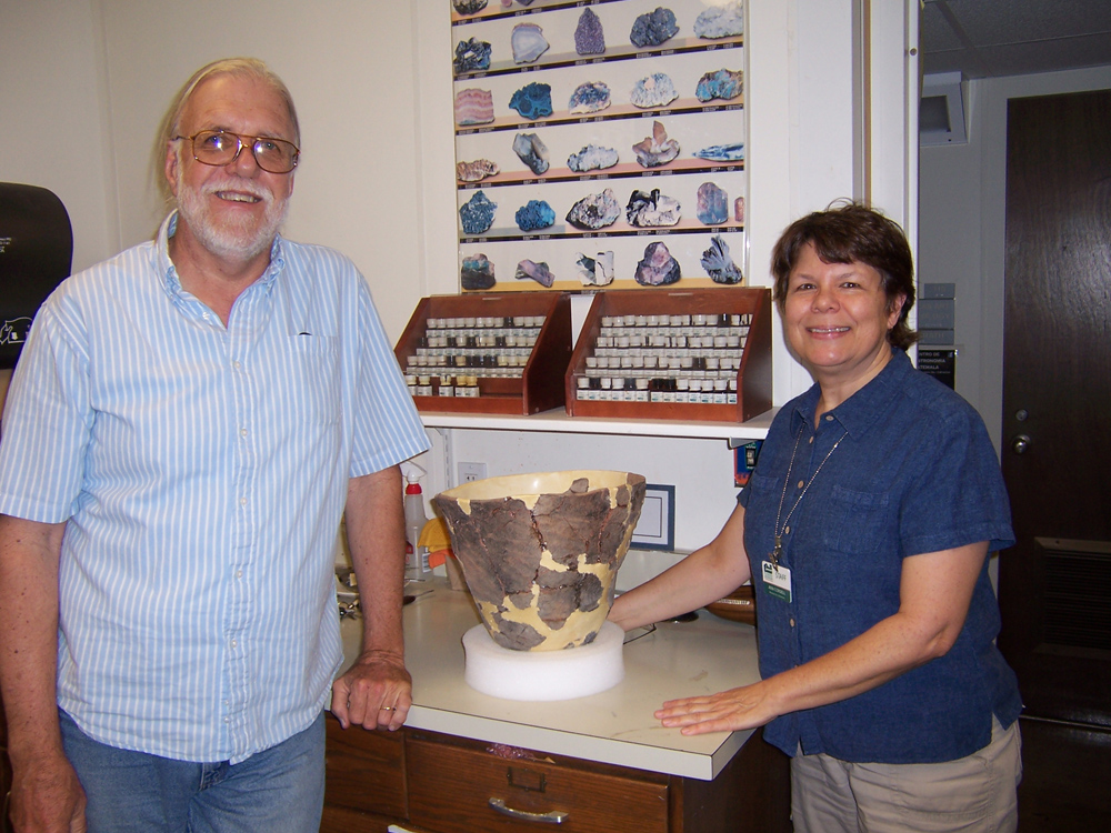 SAN PEDRO COB-MARKED POT. Archaeologist Carl Halbirt with Anne Cordell, UF Ceramic Specialist, who reassembled the 5-pound Native American vessel.
